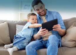 dad with kid looking at a tablet