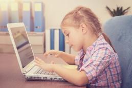 kid using laptop at home