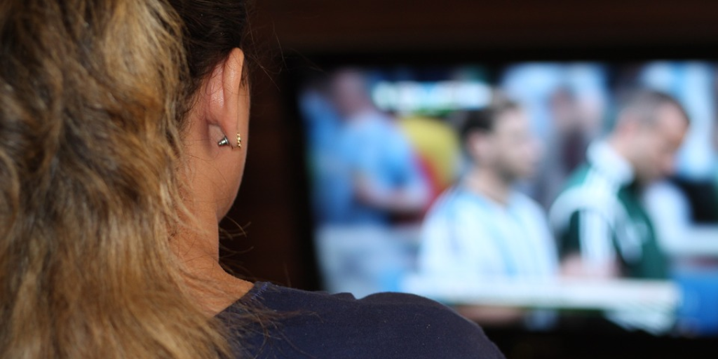 girl-watching-sports-on-television